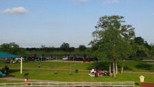 The dog park is just beyond the line of cars. Nice surrounding area.